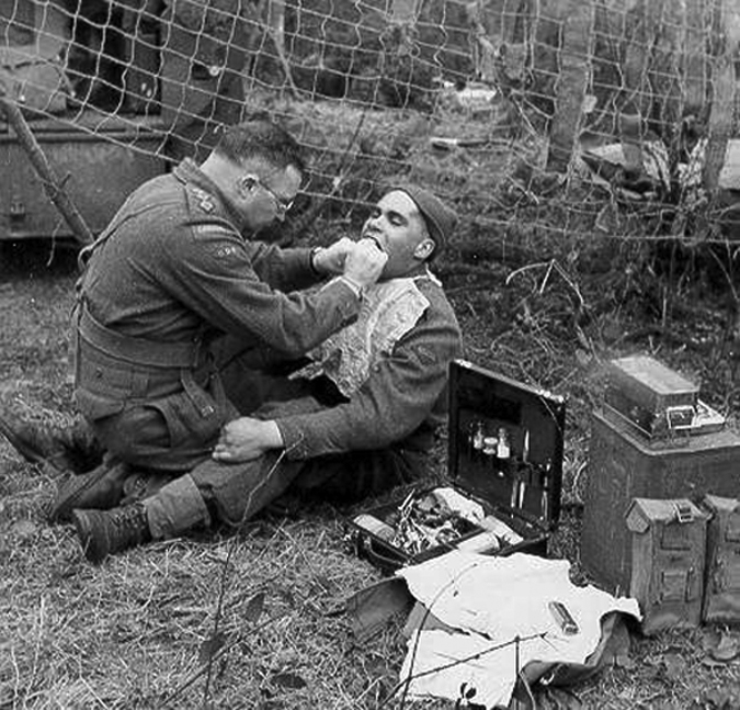 A dentist works on a patient in the field during WWII.  The use of dental records for forensic purposes, especially in identifying war casualties, came into prominence during WWII. Many fatalities lacking any other means of identification were identified by military dentists.