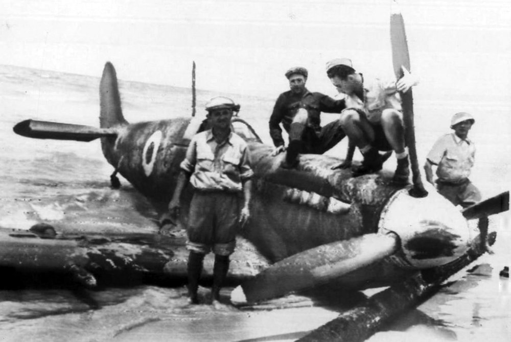 Israelis examine a Spitfire IX of No. 2 Squadron, Royal Egyptian Air Force, that was brought down by ground fire during a strike on Tel Aviv on May 15, 1948, and belly landed on the beach at Hertzliya. The pilot, Flight Lieutenant Mahmoud Barakat, was taken prisoner. (israel defense force)