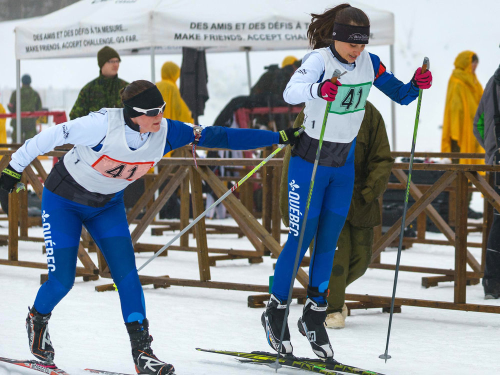 Cadet Anne Morcet (left) tags her Team Quebec teammate Cadet   Geneviève Harvey during the relay race at the Cadet National Biathlon Championship on March 1, 2017 at the Myriam Bédard Biathlon Centre.