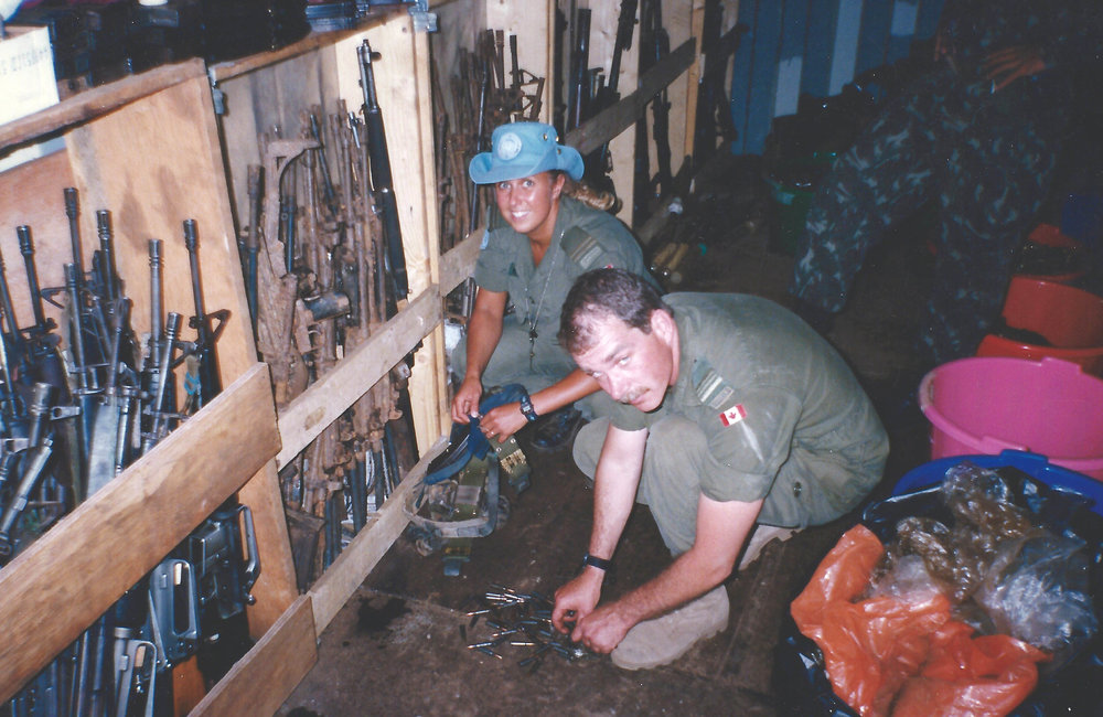 Eva Martinez and Paul Lansey storing weapons and ammunition collected from the guerrillas.