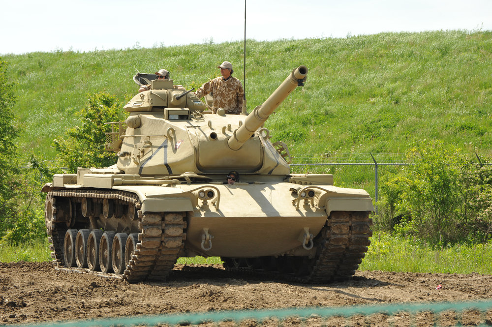 Esprit de Corps writer David Pugliese rides in a M60 tank during the Aquino Tank Weekend. Photo by Scott Taylor