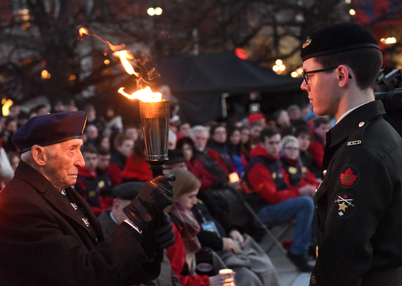 On April 8, 2017, during the annual Army Cadet Battle of Vimy Commemoration candlelight ceremony in Ottawa, CWO Michael Robichaud passes the Torch of Remembrance to a veteran in a symbolic act of remembering those who fell during the Great War. (fred cattroll)