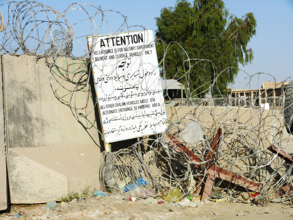 The entrance to an abandoned Canadian Provincial Reconstruction Team camp in Kandahar, left to go to ruin after NATO's withdrawal from Afghanistan. (scott taylor)