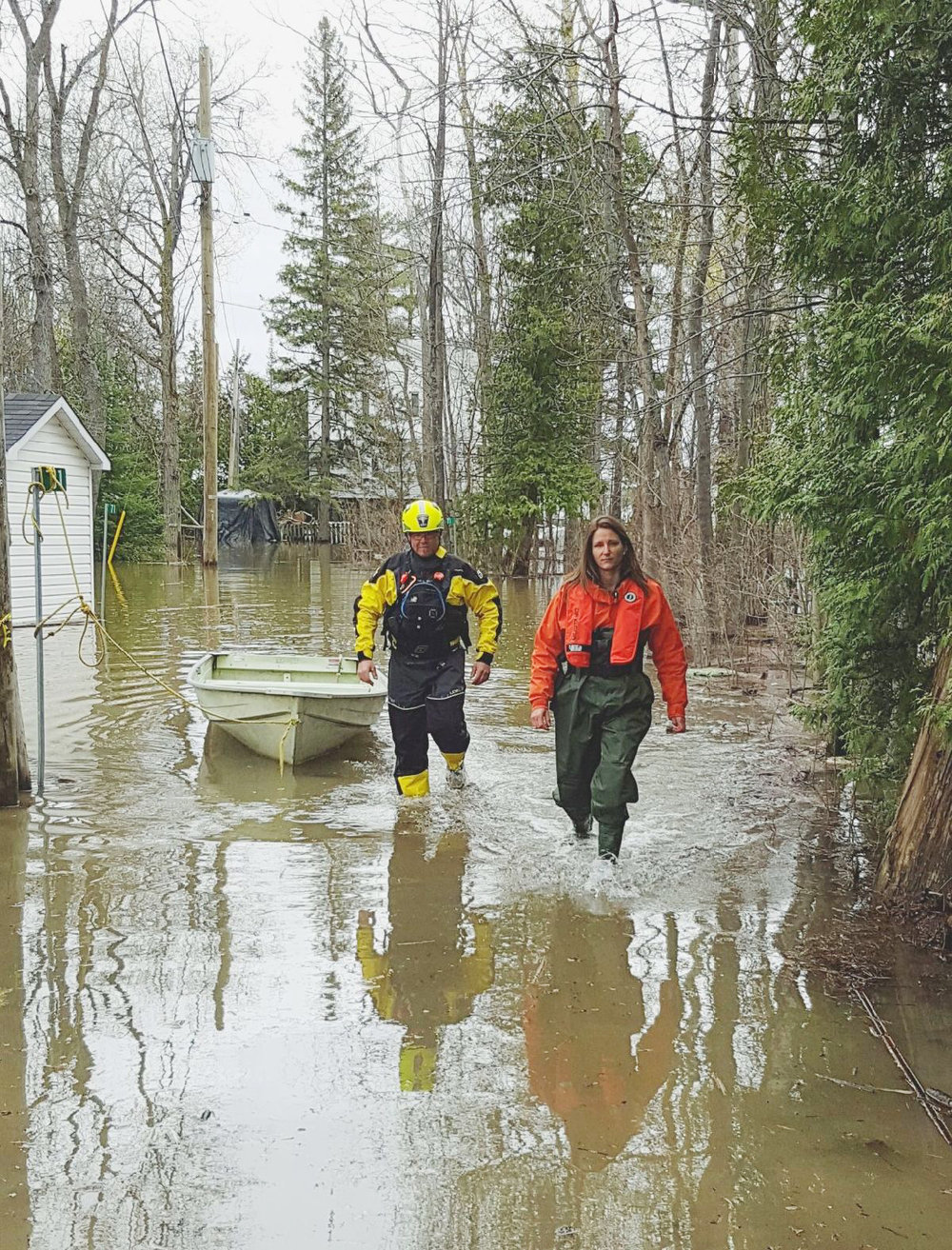 Author Eva Cohen (right) walks through a flooded neighbourhood in County Renfrew, west of Ottawa, in May 2017. A volunteer expert in urban search and rescue with the German Federal Agency for Technical Relief (THW), Cohen believes Canada should have a volunteer-based emergency preparedness organization to proactively respond when a natural disaster looms.