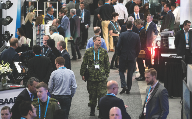 Members of the Canadian Armed Forces receive complimentary access to CANSEC and many take advantage to visit the booths and see what systems and technology are currently available from the defence industry and what prototypes are being devised for the military of the future. (cadsi flickr)