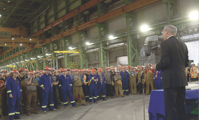 Above, Kevin McCoy, president of Irving Shipbuilding, and hundreds of employees at the Halifax Shipyard marked the start of production of the first Arctic Offshore Patrol Ship in September 2015. Irving recently announced that delays on the Canadian Surface Combatant program's bids will not delay the start of ship construction. (cnw group, j.d. irving limited)