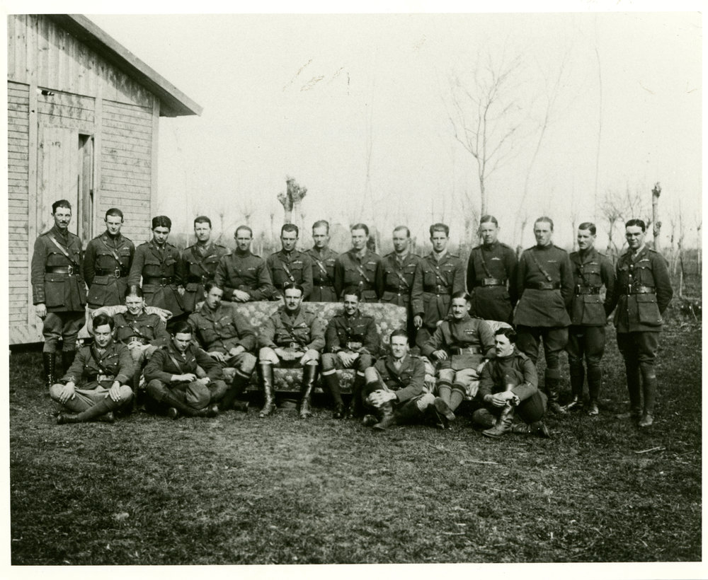 "Of the pilots of No. 66 Squadron RFC photographed at San Pietro in Gu in March 1918, Birks remembered the following: standing, second from left, Lt. Christopher McEvoy (9 victories); third, 2nd Lt. Charles C. Robinson; fifth, Lt. Francis S. Symondson (13), sixth, 2nd Lt. Herbert N.E. Row (3), seventh, 2nd Lt. Robert G. Reid (3), ninth, 2nd Lt. Henry B. Homan (killed in crash, 4 April 1918), twelfth, 2nd Lt. Gordon F. Mason Apps (10);  and thirteenth, 2nd Lt Gerald A. Birks (12). Seated, first from left, 2nd Lt. Norman S. Taylor (3), second, Captain William Topham, recording officer, third, 2nd Lt. Stanley Stanger (13 victories), fourth, Capt. John W. Warnock, ""my first flight commander"" (1), fifth, Maj. John TudorPowell Whittaker, squadron CO; sixth, Capt. Hilliard Brooke Bell (9), seventh, 2nd Lt. Alan Jerrard, who on 30 March was taken prisoner in an action that earned him the only Victoria Cross awarded to a Camel pilot (7); eighth, Capt. Peter Carpenter (24); and Lt. Harold R. Eycott-Martin (8). (gerald birks album, courtesy jon guttman)"
