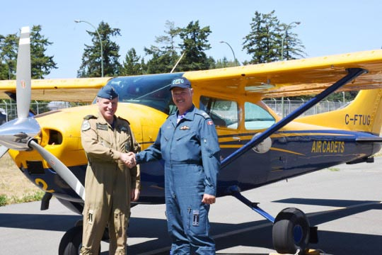 Major Rob Allison (left) congratulates Civilian Instructor Laszlo Nemedy on qualifying as a Tow Pilot for the Glider Program at Comox cadet flying training Centre. Photo: Cadet Correspondent Murray Meldrum (18).