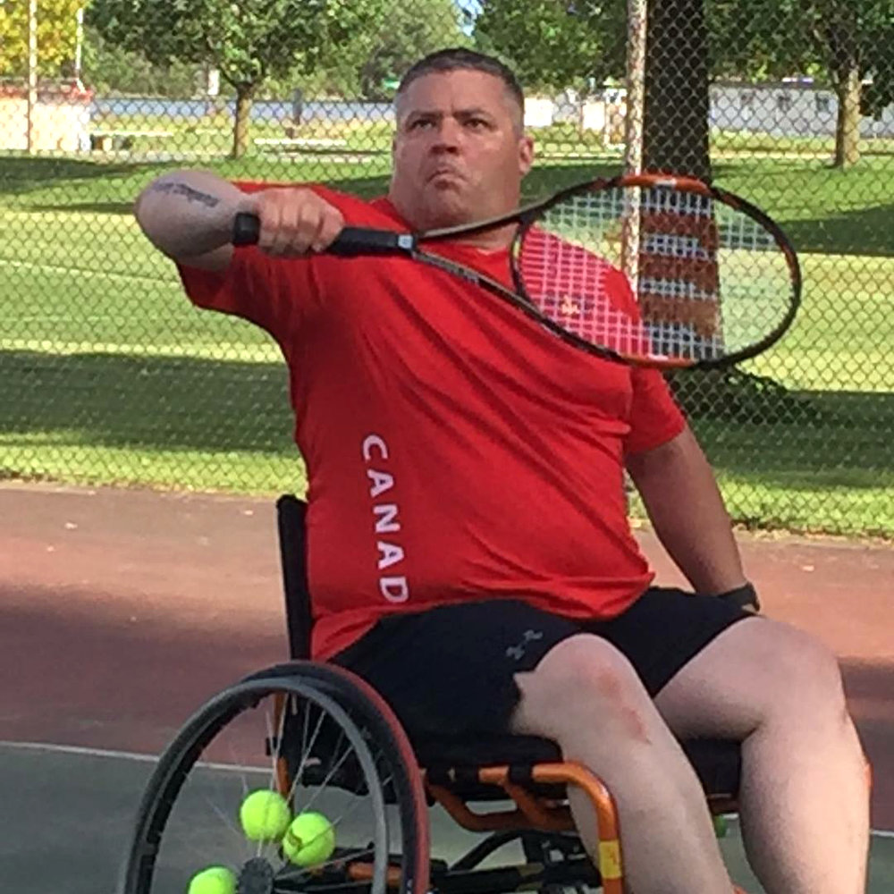 Phil Badanai, recipient of the Meritorious Service Medal for his actions as a peacekeeper in Croatia, wanted to increase his chances of making Team Canada so he chose what he thought would be unpopular sports to compete in. He also gave himself a few extra challenges, like wheelchair tennis and rugby (aka murderball).