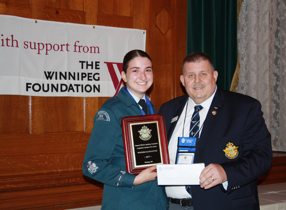 WO1 Heather Blake, who took honours this year for her speech on women in aerospace, received her award from Donald Berrill, National President of the Air Cadet League of Canada.
