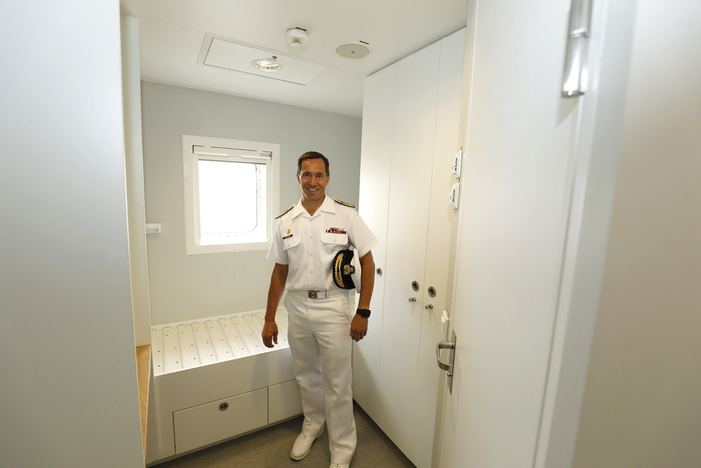 RAdm Gilles Couturier views the personnel quarters while touring the MV Asterix after the official unveiling ceremonies were completed on July 20. The ship has the capacity to house 150 regular personnel, in addition to emergency accommodation for up to 350 people. (chantier davie)