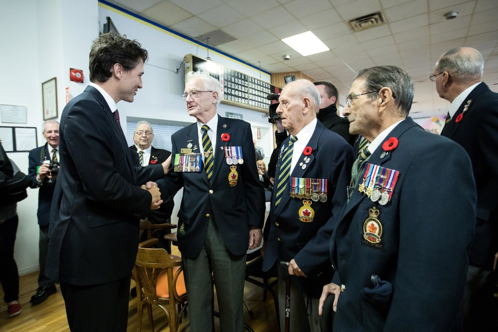 Prime Minister Justin Trudeau speaks with staff and veterans at the newly opened Veterans Affairs office in Sydney, Nova Scotia on November 10, 2016. As part of Budget 2017, the Liberal government has promised to provide more funding for the health and welfare of military members and veterans. (adam scotti, pmo)