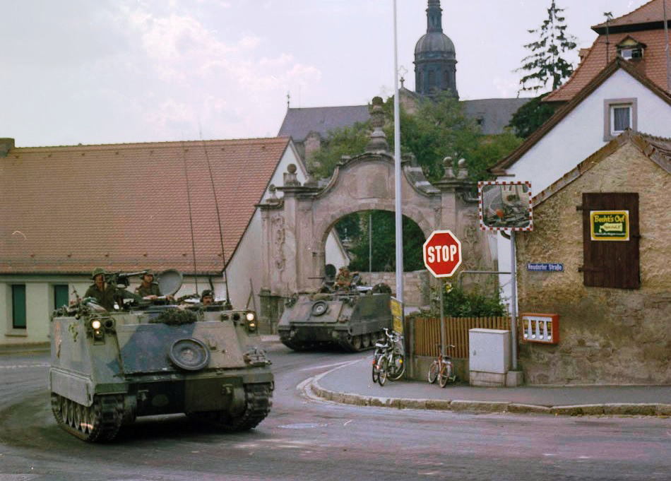 M113 armoured personnel carriers (APCs) from 4 Canadian Mechanized Brigade Group on manoeuvers during FALLEX in 1982 in Germany. During the Cold War, Canada's military maintained several bases and stations throughout Europe. (lac, mikan 4876348)