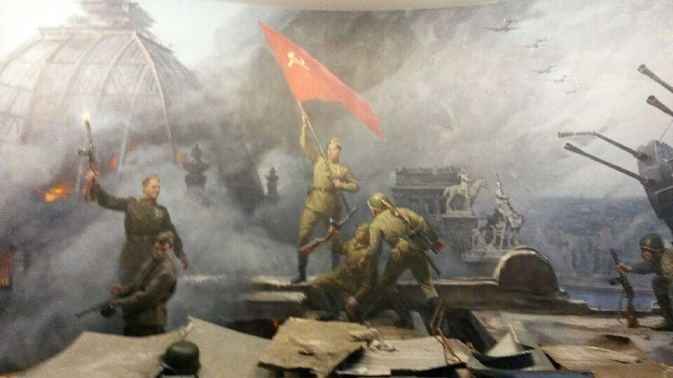 At the Astana war museum, a giant moral proudly depicts the Kazakh soldier who placed the Soviet flag atop the German Reichstag during the Battle of Berlin, May 1945