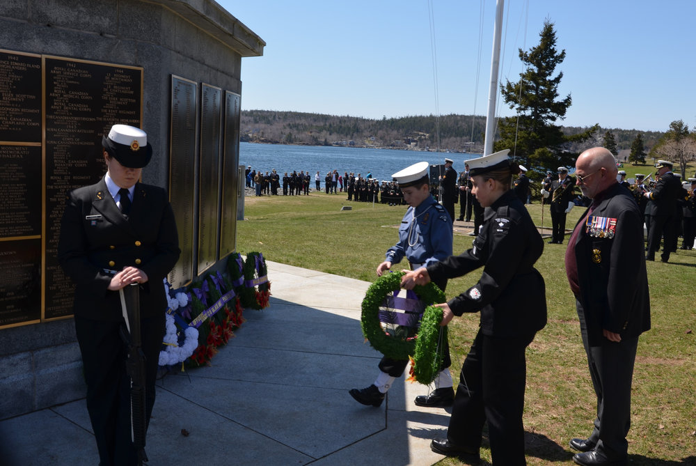 Earle Corn, National President of The Navy League of Canada, accompanies a Sea Cadet and a Navy League Cadet to lay wreaths in memory of our veterans. OPPOSITE PAGE: Corn at the National AGM.