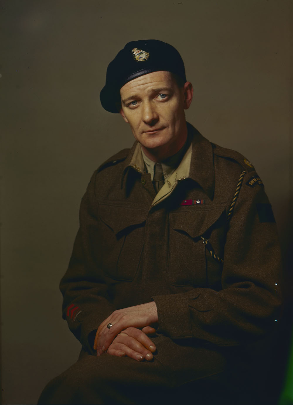 "This portrait captures Currie's calm, abiding demeanour. Asked his response to being awarded the Victoria Cross, he responded, ""Well, I was staggered. I sat down and had a cigarette and thought it over."" According to his son, ""He was always a cool guy. Absolutely no flapping, no matter what."" Currie's medals, including his VC (one of only 12 awarded to Canadians fighting in Canadian units in WWII), will be auctioned off on September 27, 2017 in London; opening bid is $500,000. (dnd, lac, mikan   4233304  )"