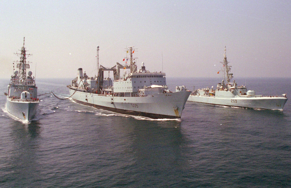 Different times: Aerial view of a Royal Canadian Navy Task Group vessels conducting a replenishment at sea en route to the Persian Gulf in September 1990 (from left): HMC Ships  Athabaskan ,  Protecteur  and  Terra   Nova , one of seven Restigouche-class destroyers that were in service between 1958 until 1998. In September 2014, the RCN announced the retirement of  Protecteur , along with sister ship  Preserver  and the last two remaining Iroquois-class destroyers  Iroquois  and  Algonquin . (dnd)