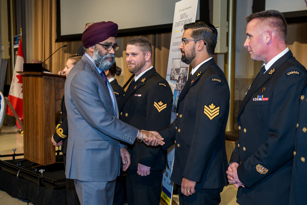 MND Harjit Sajjan gives coins to deserving sailors