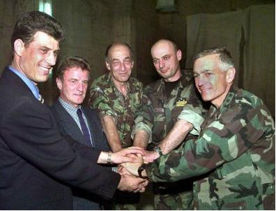 Hashim Thaci (left) circa 1999, celebrating NATO's victory in Kosovo