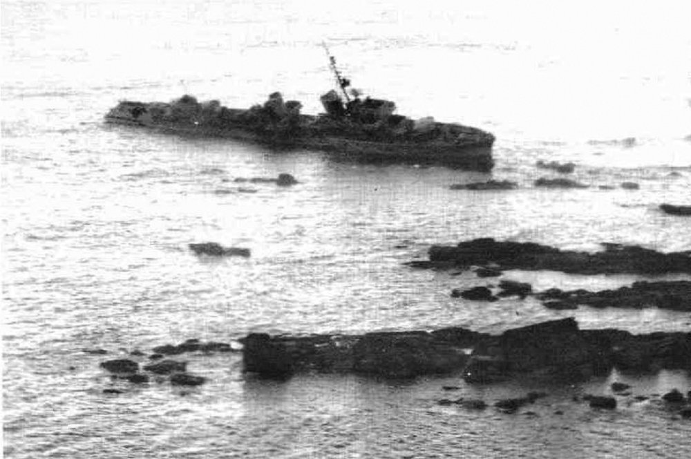 The German destroyer  Z-32 , hard aground on Île de Batz off the Brittany coast the day after the battle. This photograph was taken by a Spitfire of No. 541 Squadron. The vessel's forward twin turret is pointed in the direction from which HMCS  Haida  and  Huron  were firing in the final stage of the battle. She was destroyed later that day by Allied aircraft, including Beaufighters from the RCAF's No. 404 Squadron.