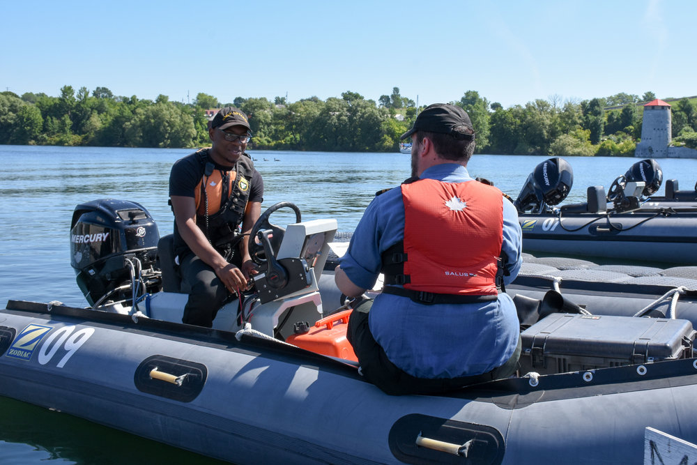 Staff Cadet Elijah Glasgow from RCSCC Niagara briefs Lt(N) Peter Hutchinson on powerboat operating procedures. (staff cadet jessica d'souza, hmcs ontario cadet training centre, dnd)