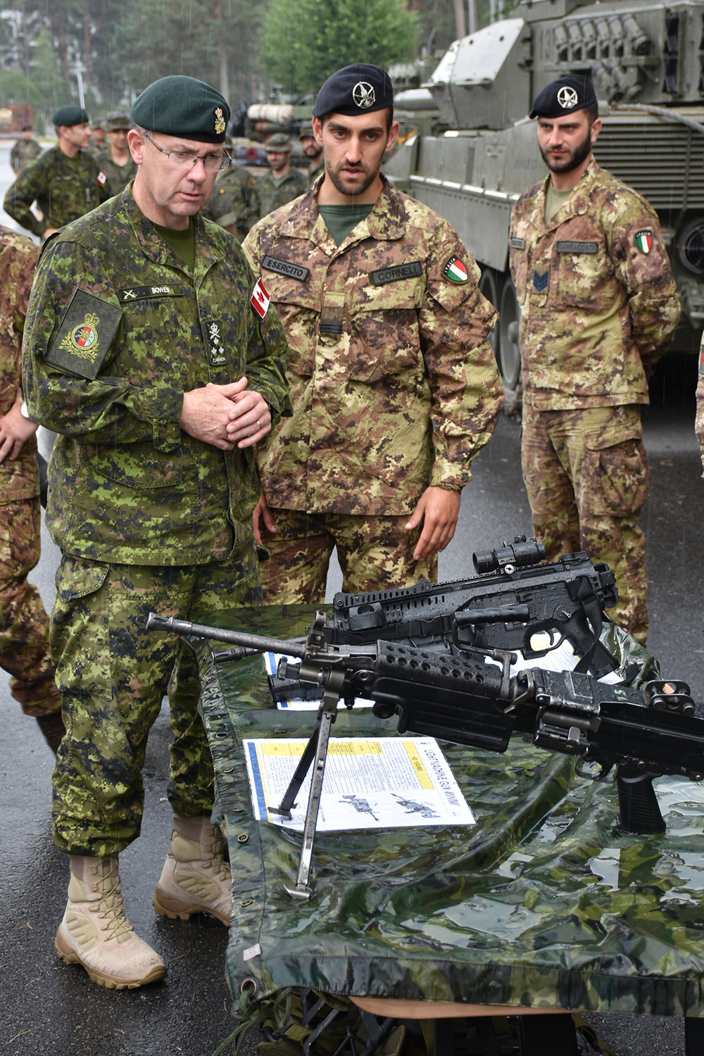 During his tour of a vehicle/equipment display, LGen Stephen Bowes was given a presentation on some of the weapons the Italian military (top right) is currently using in the Latvian theatre. (photos by mcpl gerald cormier, efp bg latvia public affairs, dnd)