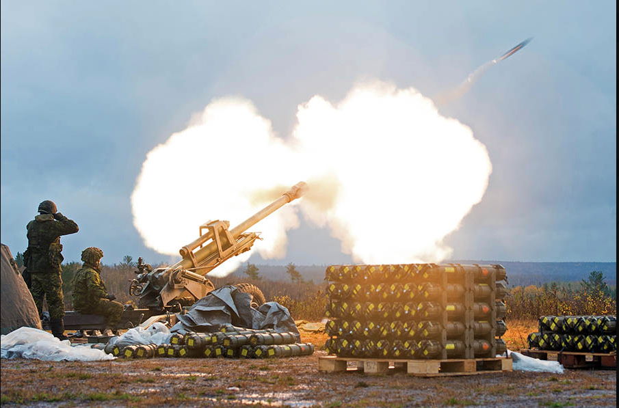 Artillery soldiers conduct a practice shoot at 5th Canadian Division Support Base during Exercise TURBULENT WINDS on October 26, 2017. Canadian Army researchers are investigating cutting-edge materials with the potential to make munitions more powerful and reducing their potential for collateral damage. Photo: Mylene Frenette, Combat Training Centre, Gagetown. ©2017 DND/MDN Canada.