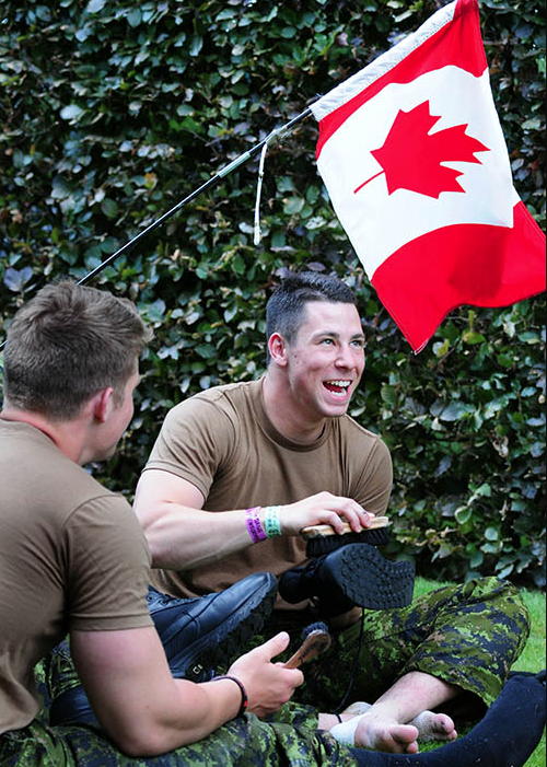Corporal Devin Birkby, a member of the 36 Canadian Brigade Group Marching Team, cleans his boots at Groesbeek Cemetery in the eastern Netherlands on July 23, 2015. Safety footwear required for many jobs in the Canadian Armed Forces are not provided by units and the organization has changed the process for reimbursing members for those purchases. Photo: Warrant Officer Jerry Kean, 5th Canadian Division Public Affairs. ©2017 DND/MDN Canada.