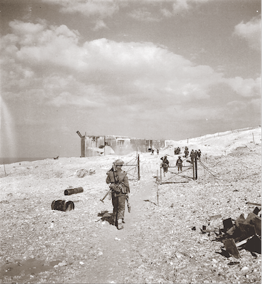 North Shore (New Brunswick) Regiment soldiers advance on a cross-channel gun position west of Sangatte during Operation UNDERGO. The elevated area surrounding the port of Boulogne was heavily defended by the Germans. If the Canadian advance was to succeed, they would need to eliminate the batteries and pillboxes at La Trésorerie first. (donald i. grant, pa–  133139  )