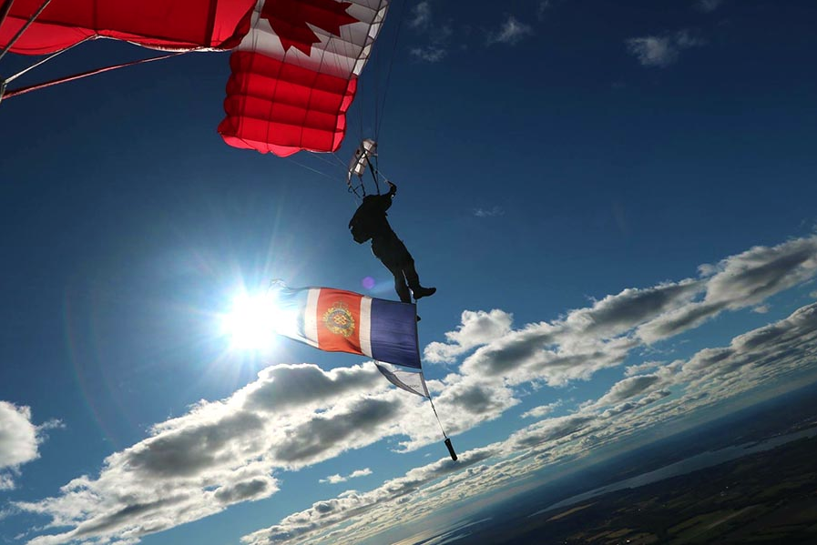 Corporal Jason Bent, a SkyHawks parachute rigger and proud Logistician, flies the Logistics Branch's 50th Anniversary Flag and Pennant during a sky dive at Trenton, Ontario in September, 2017 as part of a global flag relay in advance of the anniversary on February 1, 2018. Photo: Master Corporal Jeremy Canfield, Canadian Army Advanced Warfare Center. ©2017 DND/MDN Canada.