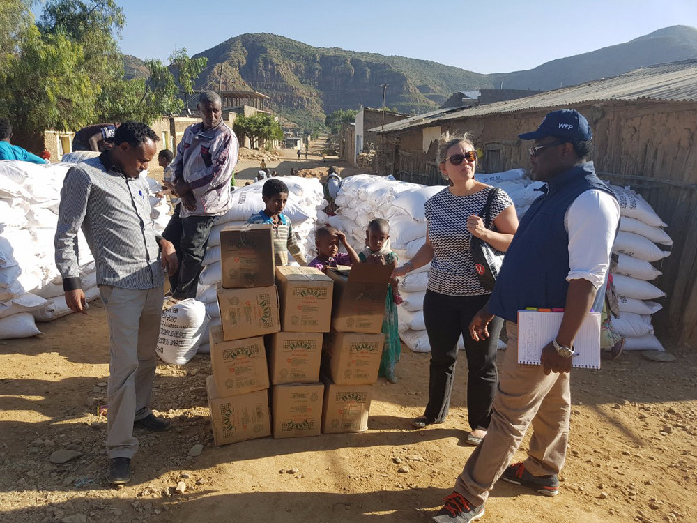 DFID Humanitarian Affairs Officer Heidi Carrubba and CANADEM Consultant Perseverence Ganga (right) monitor a food distribution site in the Tigray region of Ethiopia in November 2016. CANADEM quickly deploys experts to support UN agencies' personnel needs during rapid-onset humanitarian emergencies and disasters. CANADEM rosters a bank of qualified experts, which the UN hires from as needed. (canadem)