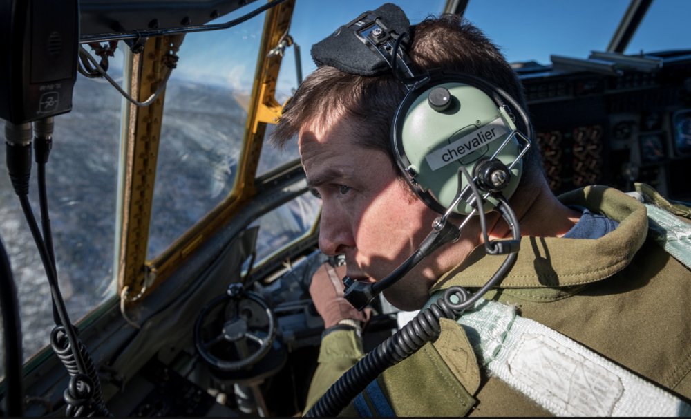 First Officer Captain Maxime Chevalier manoeuvres a search and rescue aircraft over the Cascapedia River Valley, in Québec. PHOTO: Corporal Neil Clarkson, GD05-2018-0060-020