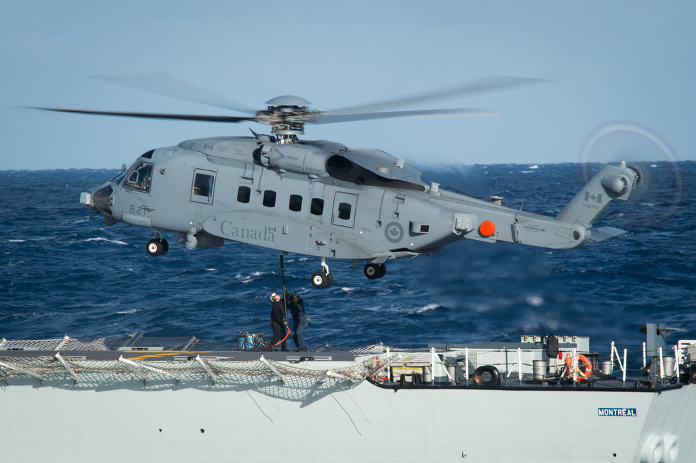 Crew members onboard HMCS  Montreal  conduct vertical replenishment training with the CH-148 Cyclone helicopter in the Atlantic Ocean in 2016. The CH-148 Cyclone will replace the CH-124 Sea King as Canada's main ship-borne maritime helicopter. On June 19, 2015, the Government of Canada accepted the first long-awaited six of a total 28 CH-148 Cyclones as part of the Maritime Helicopter Project. (mcpl jennifer kusche, dnd)