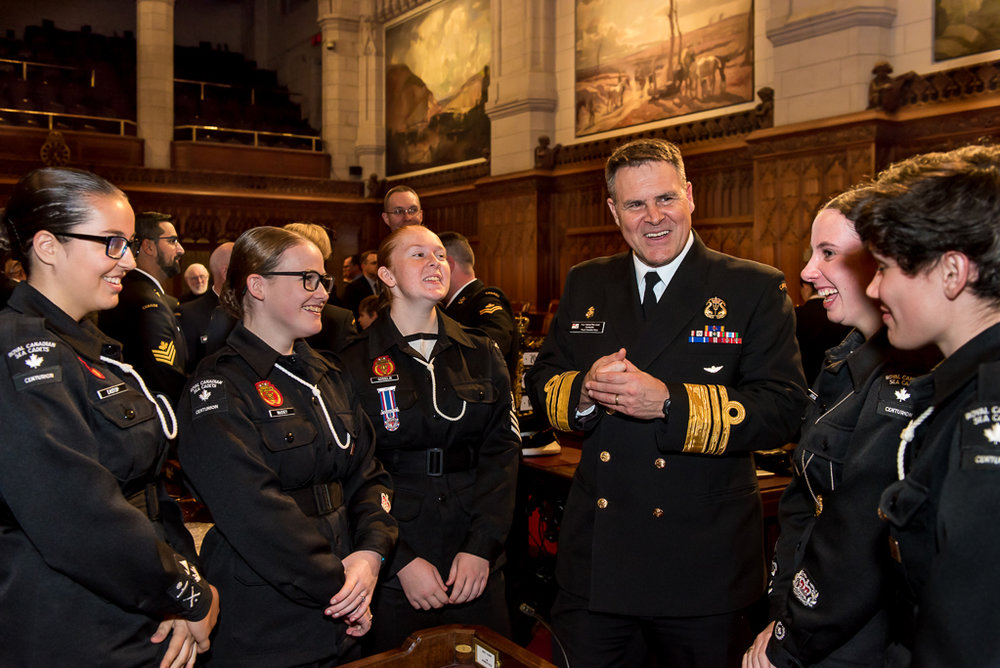 VAdm Ron Lloyd, Commander of the Royal Canadian Navy, talks with local Sea Cadets during the award ceremony, held in the Senate Chamber on Parliament Hill, for the Navy and Coast Guard Day in Ottawa on November 20, 2017. (richard lawrence)