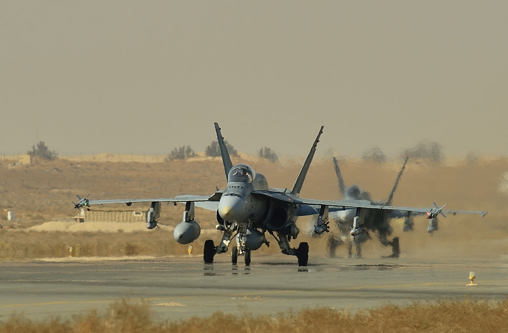 Royal Canadian Air Force CF-18 fighter jets taxi on the runway in Kuwait during Operation IMPACT on November 13, 2014. The start of the competition to replace the current fleet of 76 modernized fighter aircraft has officially begun, although a decision on the winning bid will not be announced until at least 2019. (Canadian Forces Combat Camera, DND)