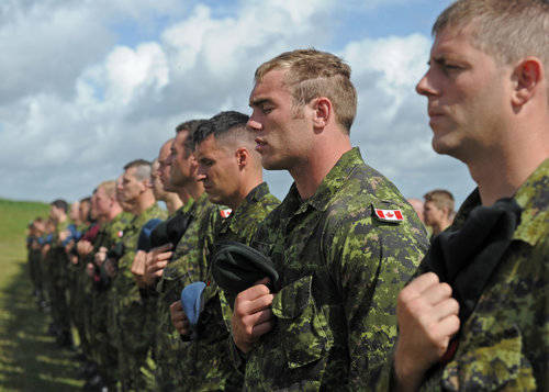 Prime Minister Justin Trudeau speaks with Canadian Armed Forces members participating in Operation LENTUS in Lamèque, New Brunswick on February 3,  2017. As with most election promises, keeping them once in power is always difficult to do. (wo jerry kean, dnd)