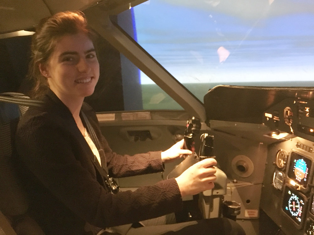 Madeleine Landreville of 51 Canada Aviation and Space Museum RCACS in a Dash 8 flight simulator as part of the Jazz Aviation Pathway Award for Professionalism and Diversity.