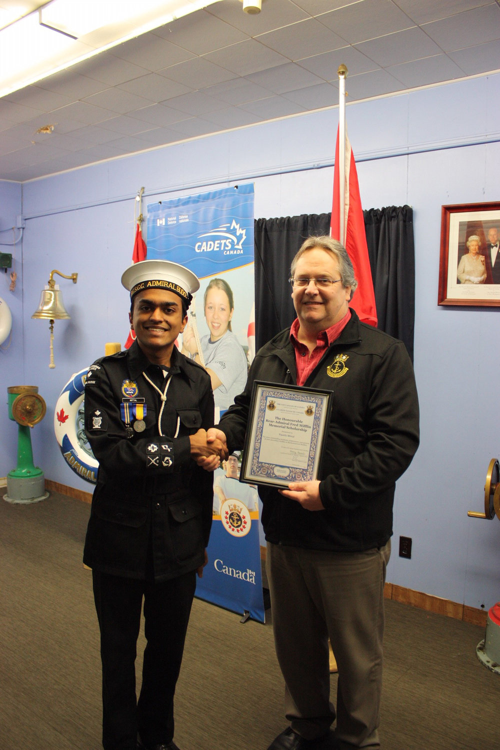 Vancouver Island Division President Brett Anderson presents The Honourable Rear-Admiral Fred Mifflin Memorial Scholarship to CPO1 Paarth Mittal on behalf of The Navy League of Canada.