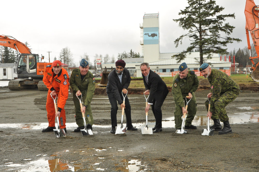 WO François Duchesneau, Search and Rescue Technician; BGen Sean Boyle, Deputy Commander 1 Canadian Air Division; Harjit Sajjan, Minister of National Defence; Boris Burlot, CEO AirPro; LCol Curtis Wright, A/Wing Commander; and CWO Keith Sexstone, A/ Wing CWO at the official groundbreaking at CFB Comox. (cnw group, airbus defence and space)
