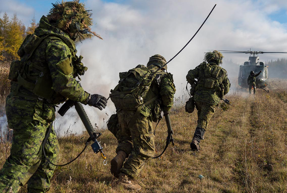 Soldiers of the 128th Battery from 4 General Support Regiment participate in Exercise TURBULENT WINDS to support an Air Defense Troop Sergeant-Major course in the training area of 5th Canadian Division Support Base Gagetown, Oromocto, New Brunswick, in October 2016. The CAF has a new program to equip eligible members with temperate boots that better meet individual fit, form and functional requirements. Offering entitled members greater flexibility and choice when it comes to operational footwear will help match the right footwear with each individual, enhancing ability to perform. Photo: Corporal Peter Ford, Tactics School, 5th Canadian Division Support Base Gagetown. ©2016 DND/MDN Canada.