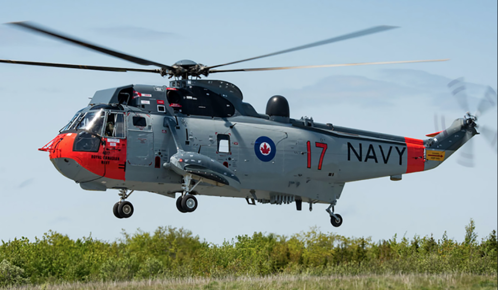 Sea King helicopter CH12417, painted in 1963 Royal Canadian Navy livery, hovers in Shearwater, Nova Scotia, in June 2018. PHOTO: DND, Corporal Cody Chaisson