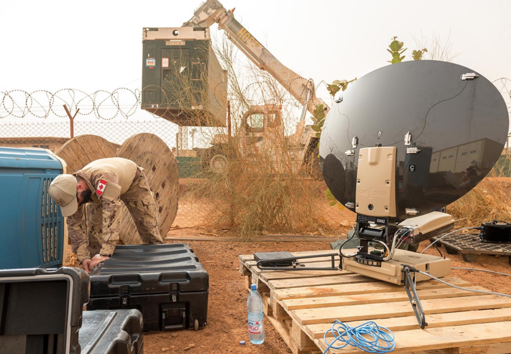 An Army Communications Information System Specialist with Operation PRESENCE - Mali sets up the Land Force Portable Satellite Terminal at Camp Castor in Gao, Mali on June 26, 2018. Photo: Canadian Forces Combat Camera. ©2018 DND/MDN Canada.