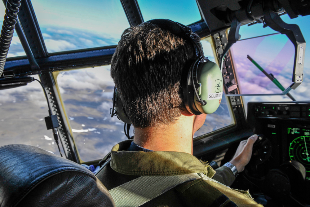 Captain Dmitrii Scurtu, from 436 Transport Squadron, pilots a CC-130J Hercules on a routine mission to Canadian Forces Station Alert, Nunavut, on July 24, 2018. PHOTO: Second Lieutenant Kathleen Soucy