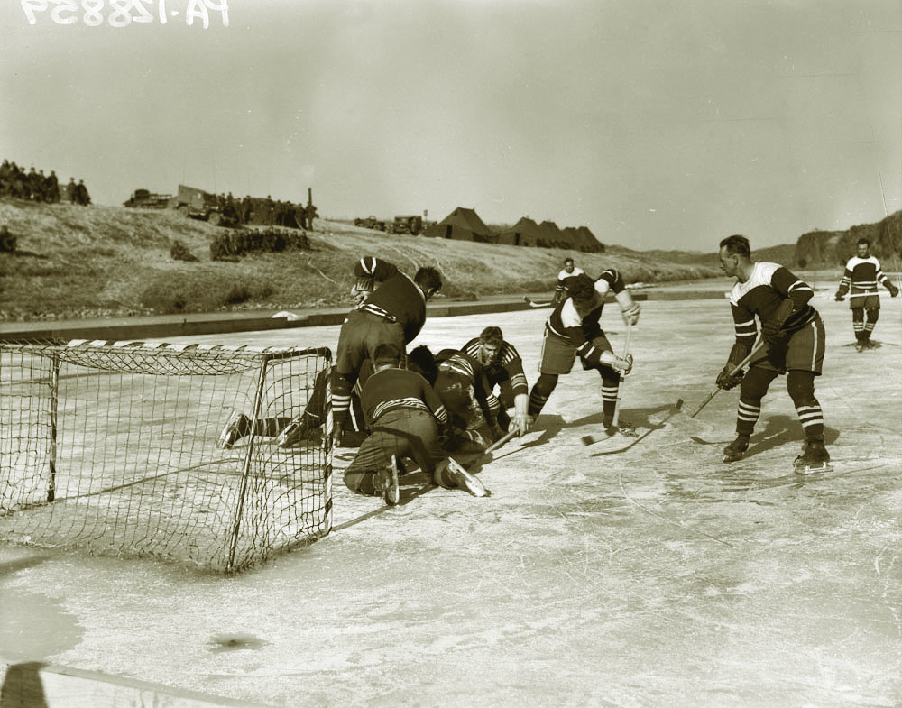 : In an effort to maintain morale and keep a tenuous connection to a home front that was ignoring them, members of the Royale 22e Regiment and RCR's play hockey on the frozen Imjin River.