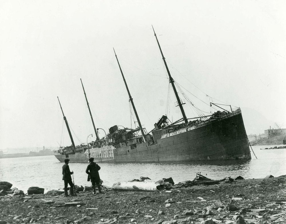 The Norwegian ship Imo, which collided with the Mont-Blanc, ran aground on the Dartmouth shore after the Halifax Explosion, 1917. Photo: Nova Scotia Archives and Records Management.
