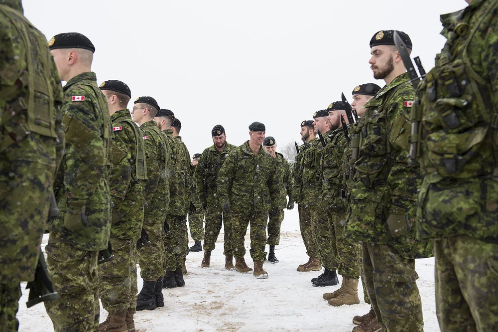 Lieutenant-General J-M Lanthier, Commander Canadian Army and Canadian Army Sergeant-Major, Chief Warrant Officer S. Hartnell inspect troops. Photo by Trooper Marc-André Leclerc, 5 Canadian Mechanized Brigade Group Public Affairs. ©2018 DND/MDN Canada.