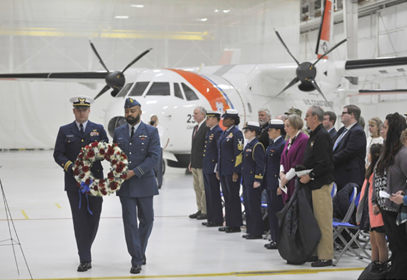 U.S. Coast Guard Lieutenant-Commander John Filipowicz (left) and Royal Canadian Air Force Captain Pete Wright present a wreath in honour of the four aircrew members of Aircraft 1432 who lost their lives while responding to an emergency situation 40 years ago. PHOTO: U.S. Coast Guard Petty Officer 2nd Class Nicole Groll, icnp2019-02-25-capecodevent