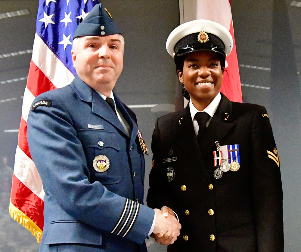Master Seaman Malisa Ogunniya is awarded the Special Service Medal with NATO bar from Lieutenant-Colonel Michael Fawcett.