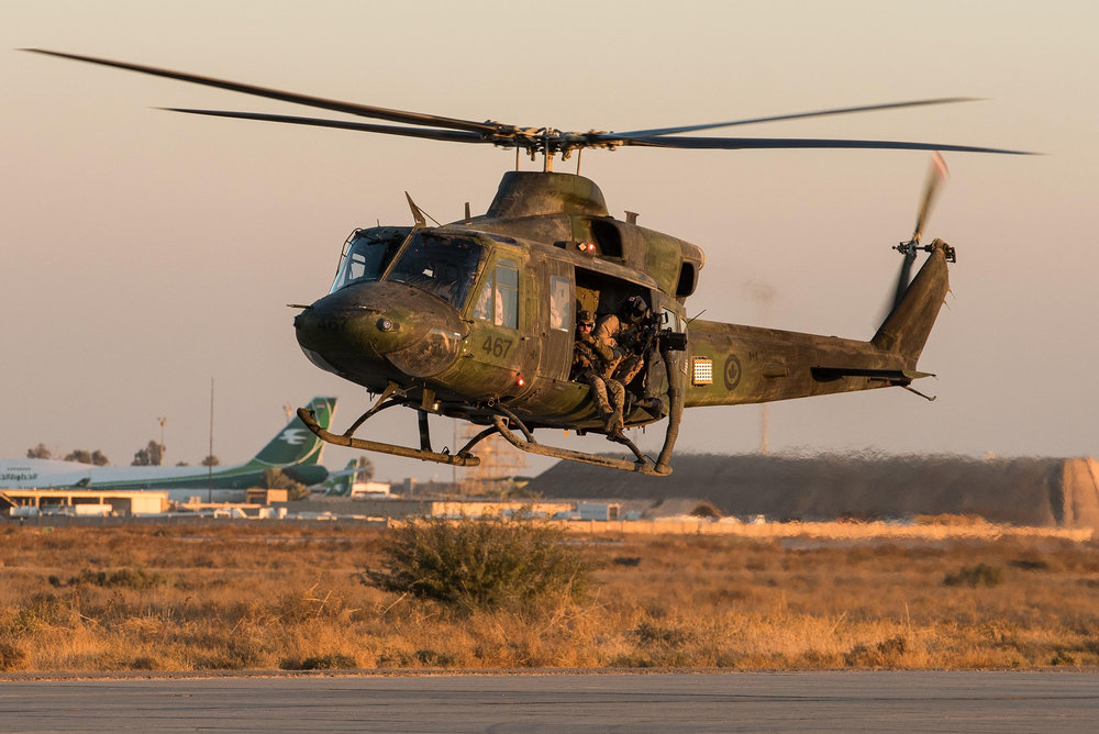 A CH-146 Griffon helicopter from 430 Tactical Helicopter Squadron takes off in Northern Iraq during Operation Impact in December 2016. PHOTO: DND, KW06-2017-0015-002