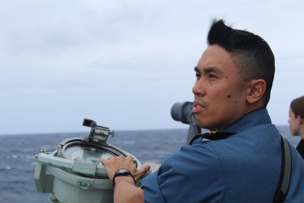 SLt Chong, BWK, looks for submarines on the horizon during Submarine Commander's Course 59.